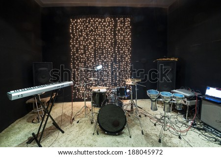 Studio room with musical instruments and record equipment - stock photo