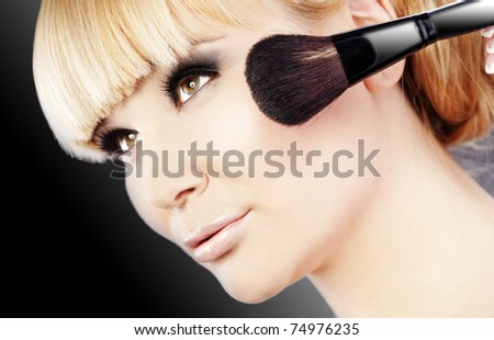 Studio series of doing fashion smokey eyes makeup - stock photo