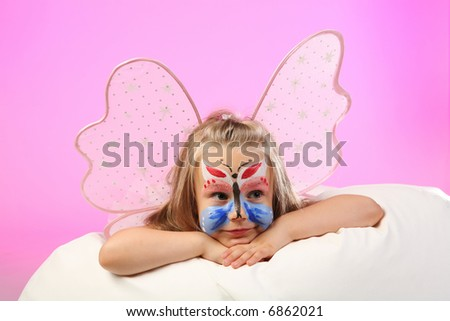 studio shoot of 4 years old girl dressed as butterfly on pink background - stock photo