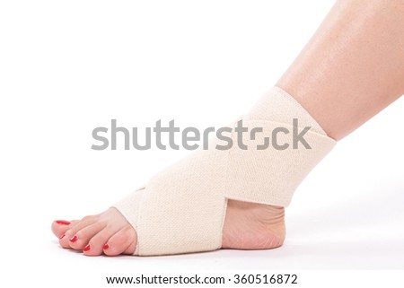 studio shot female ankle tied with an elastic bandage.