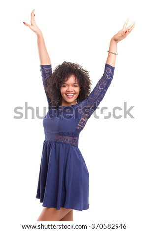 Studio shot: Happy African woman with raised arms - stock photo