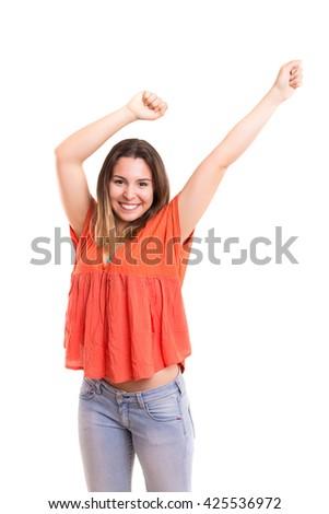 Studio shot: Happy woman with raised arms - stock photo