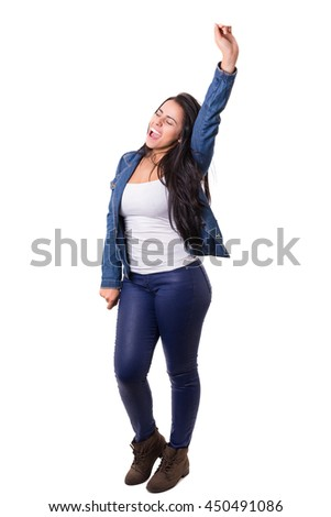 Studio shot: Happy woman with raised arms