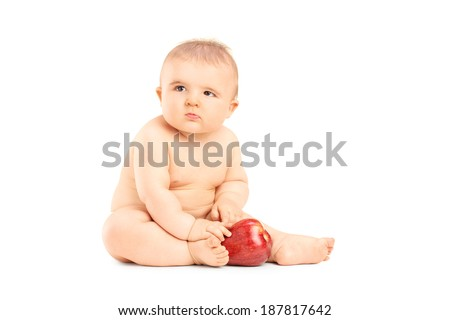 Studio shot of a baby playing with an apple isolated on white background