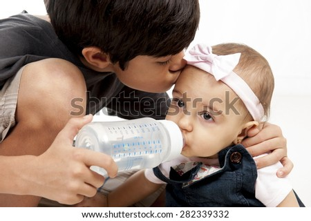 Studio shot of a boy and baby girl . - stock photo