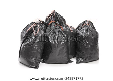 Studio shot of a bunch of garbage bags isolated on white background - stock photo