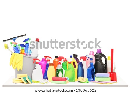 Studio shot of a cleaning supplies on a table isolated on white background - stock photo