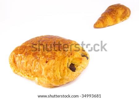 Studio shot of a croissant and a pain au chocolat. - stock photo