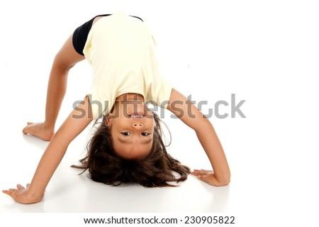 Studio shot of a cute Child playing bridge - stock photo