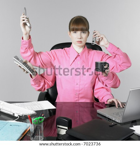 studio shot of a expressive and funny red hair young woman at the office desk having a hard time - stock photo