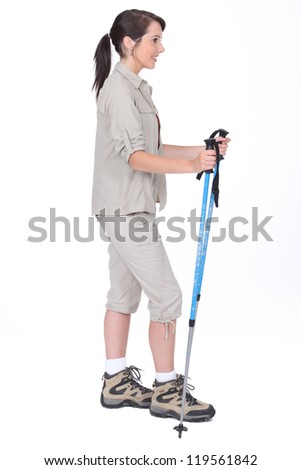 Studio shot of a female walker with poles - stock photo
