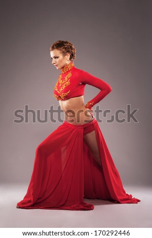 Studio shot of a gorgeous sporty woman in red clothing - stock photo