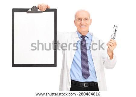 Studio shot of a mature optometrist holding a pair of glasses and a clipboard with a blank paper on it isolated on white background - stock photo