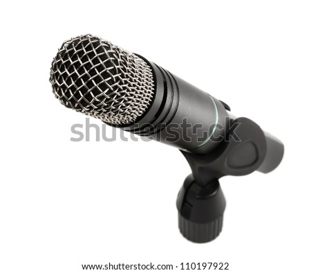 Studio shot of a microphone isolated on white background - stock photo