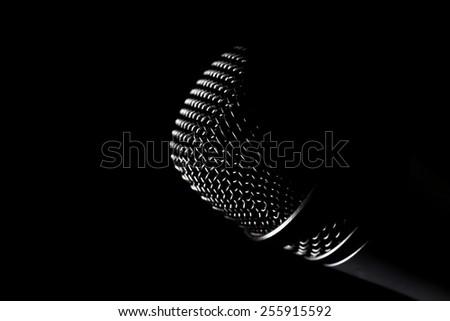 Studio shot of a microphone, on black - stock photo