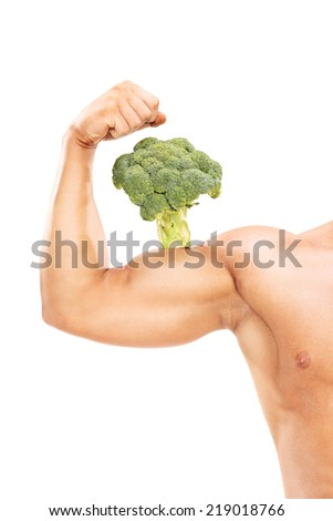 Studio shot of a muscular arm with a broccoli on the bicep isolated on white background - stock photo