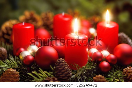 Studio shot of a nice advent wreath with baubles and two burning red candles - stock photo