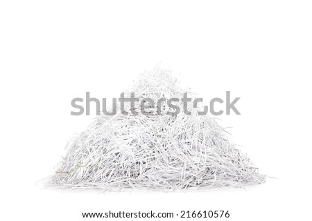 Studio shot of a pile of shredded paper isolated on white background - stock photo
