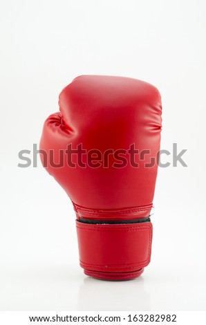 Studio shot of a red boxing glove - stock photo