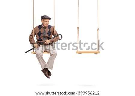 Studio shot of a sad senior sitting on one swing with an empty swing beside him isolated on white background - stock photo