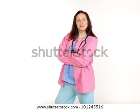 Studio shot of a smiling medical provider in scrubs with a stethoscope