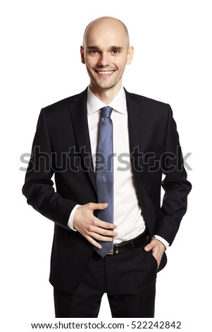 Studio shot of a smiling young man working in finance.
