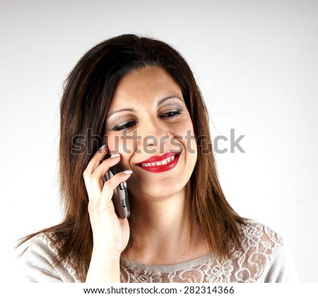 Studio shot of a woman with mobile phone