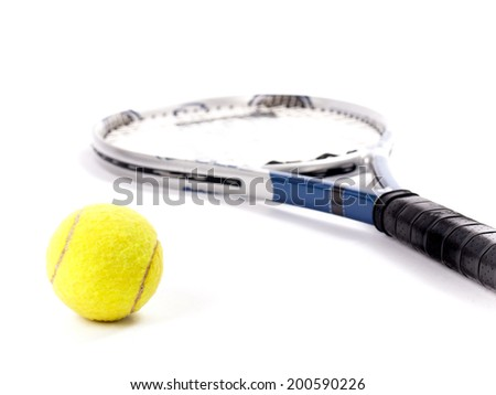 Studio shot of a yellow tennis ball and racket isolated on a white background - stock photo
