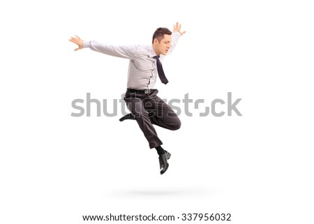 Studio shot of a young businessman jumping in the air isolated on white background - stock photo
