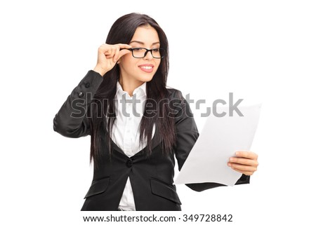 Studio shot of a young businesswoman looking at a document isolated on white background