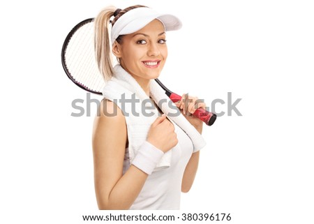 Studio shot of a young female tennis payer holding a racket isolated on white background - stock photo