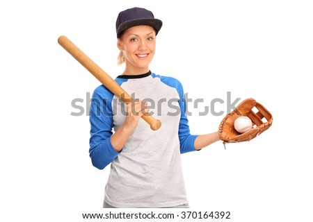 Studio shot of a young woman holding a baseball bat and looking at the camera isolated on white background - stock photo