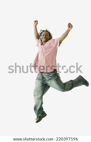 Studio shot of African man jumping - stock photo
