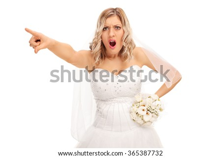 Studio shot of an angry bride pointing with her finger isolated on white background - stock photo