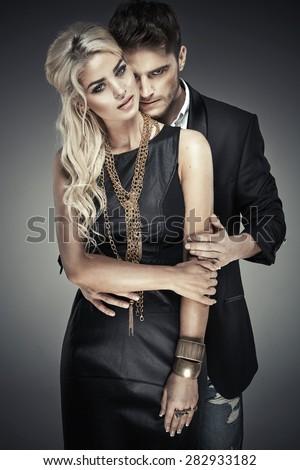 Studio shot of an elegant couple - stock photo
