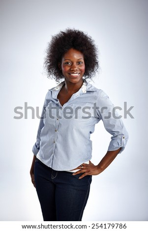 Studio shot of attractive african woman posing over white background - stock photo