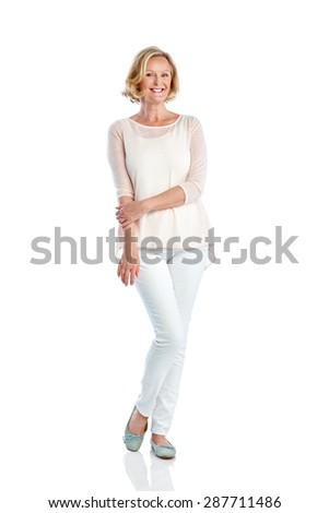 Studio shot of attractive mature woman posing on white background - stock photo