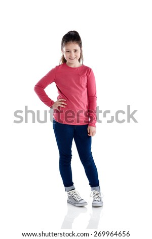 Studio shot of beautiful little girl standing on white background - stock photo