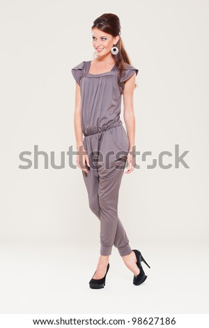 studio shot of beautiful model over grey background - stock photo