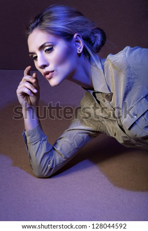 Studio shot of beautiful woman  in military clothes - stock photo