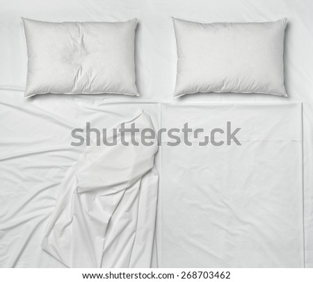 studio shot of bedding sheets and pillows - stock photo