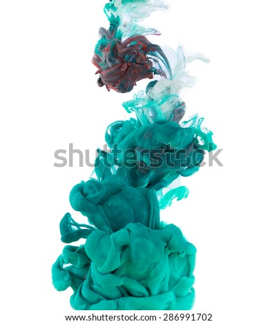 Studio shot of blue ink in water, isolated on white background - stock photo