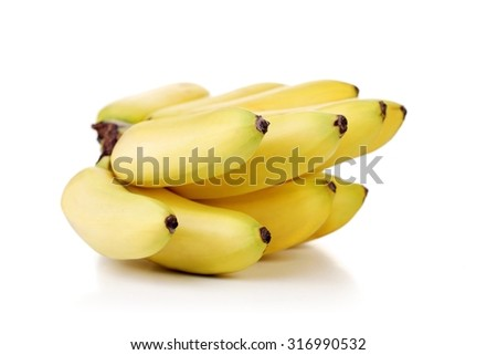 Studio shot of bunch of bananas - stock photo