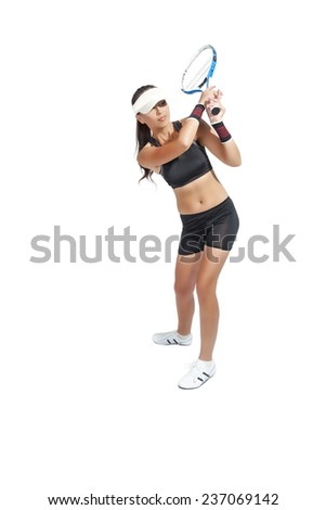 Studio Shot of Caucasian Female Tennis Player Equipped With Professional Outfit with Racket .Isolated over white background. Vertical Image Composition - stock photo