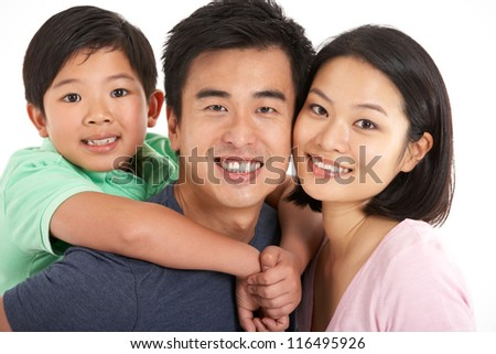 Studio Shot Of Chinese Family