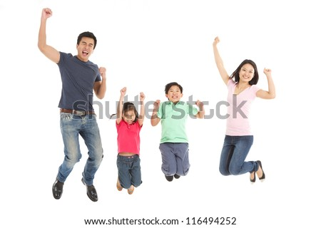 Studio Shot Of Chinese Family Jumping In Air - stock photo