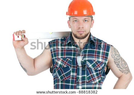 Studio shot of confident caucasian construction worker with a level, over a white background - stock photo