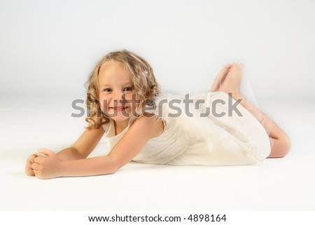 Studio shot of cute little girl as an angel - stock photo