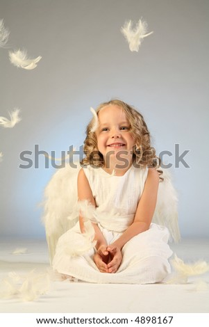 Studio shot of cute little girl as an angel