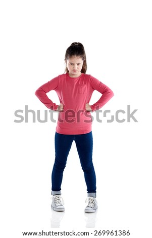 Studio shot of cute little girl looking upset standing with her hands on hips over white background  - stock photo